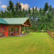 Cider house with covered deck and horse ranch — Stock Photo