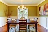 Green craftsman large dining room with cherry floor. — Stock Photo
