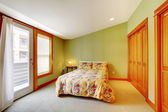Green bedroom with golden wood — Stock Photo