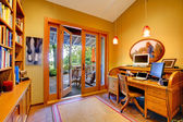 Yellow home office with an open door to the deck — Stock Photo
