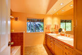Bathroom with orange yellow tones — Stock Photo