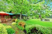 Horse farm house back yard with covered deck — Stock Photo