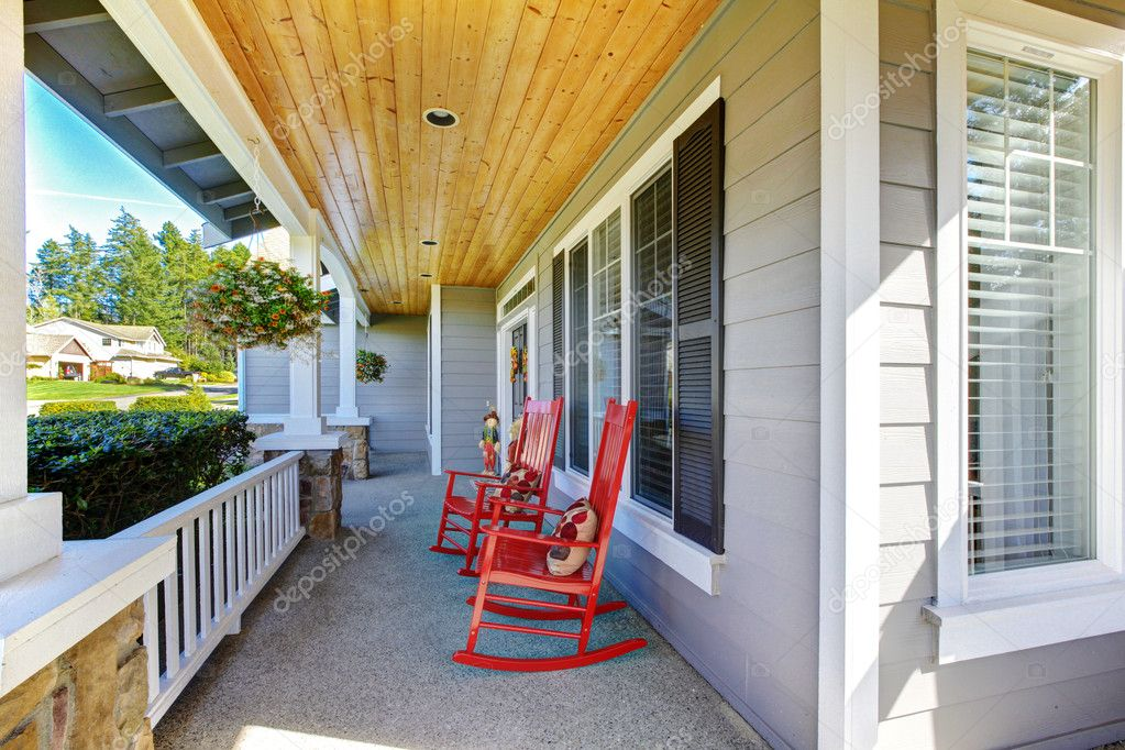 Red Rocking Chairs On Front Porch ~ Front porch with rocking chairs and cover — stock photo