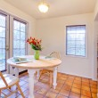 White dining room with french door and orange ceramic tiles — Stock Photo