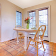 Happy dining room with orange tile floor - Stock Photo