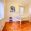 Baby room with window seat and bed — Stock Photo