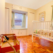 Baby room with crip and window seat — Stock Photo