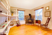 Living room in a cute country garden house with fire stove — Stock Photo