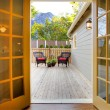 View of the deck from open kitchen french door - Stock Photo