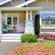 Small white cottage exterior front house shot. — Stock Photo