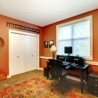 Stock Photo: Home office interior design with orange brick walls.