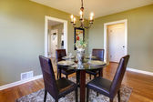 Classic dining room with leather chairs and glass table — Stock Photo
