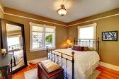 Bedroom interior with golden walls and oak floor. — Stock Photo