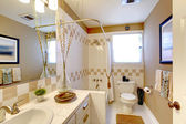 Bathroom with beige and white tiles interior. — Stock Photo