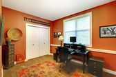 Home office interior design with orange brick walls. — Stock Photo