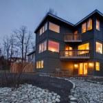 Exterior modern large grey house at night — Stock Photo