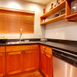 Stock Photo: Modern cherry luxury kitchen with black ans stain steal.