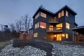 Exterior modern large grey house at night — Stock fotografie