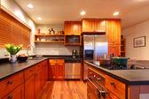Luxury modern cherry kitchen — Stock Photo