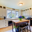 ストック写真: White antique remodeled kitchen with black island.