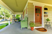 Covered front porch of theold craftsman style home. — Stock Photo