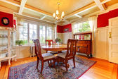 Elegant red and gold dining room with antique furniture. — Stock Photo