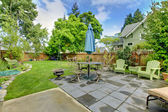 Back yard fenced with furniture and sitting area. — Stock Photo