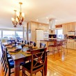 Large luxury dining room and kitchen witj shiny wood floor. — Stock Photo