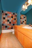 Dark blue bathroom with wood cabinet and sink. — Стоковое фото