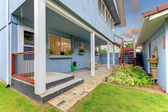 Court yard fenced with blue house and garage. — Stock Photo