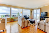 Living room with water view and luxury hardwood floor. — Stock Photo