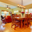 Large dining and family room with yellow walls. — Foto Stock #7898897