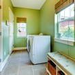 Green large bathroom with white washer and dryer. — Stock Photo