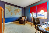 Home office in blue and red with the world map. — Stock Photo