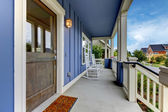 Blue house front covered porch entrance. — Stock Photo