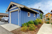 Detached garage of Blue house from the back yard. — Stock Photo