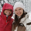 Two young laughing happy women in the snow forest — Stock Photo #7902166
