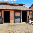 Horse stable with fenced area close to the building. — Stock Photo #7923646