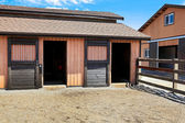 Horse stable with fenced area close to the building. — Stock Photo
