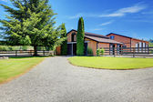 Horse farm country stable house with driveway. — Stock Photo