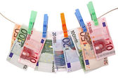 Euro banknotes on clothesline — Stock Photo