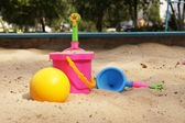 Toys in a sandbox — Stock Photo