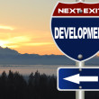 Development road sign - Stock Photo