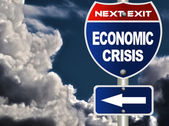 Economic crisis road sign — Stock Photo