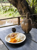 Traditional goan food: rice and fenny drink — Stock Photo