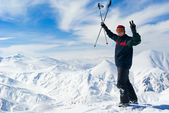 Cheerful skier on the top of mountain — Stock Photo