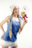 Pretty snow maiden holding bright lollipop — Stock Photo