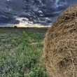 Hay Bale and Prairie Storm — Stock Photo