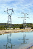 Power lines above water — Stock Photo