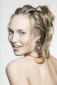 Beautiful face smiling girl with perfect skin wearing jewelry — Stock Photo